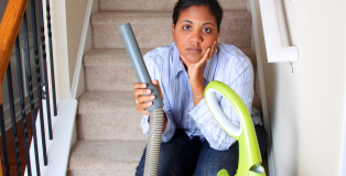 Woman cleaning in her house with a vacuum cleaner