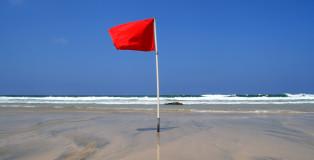 A Red Dangerous Swimming Warning Lifeguard Flag.